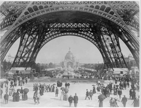 A glorious view under the canopy of the Eiffel Tower, 1880s.