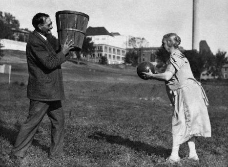 Dr. James Naismith, the inventor of basketball, practices with his wife Maude. (1928)