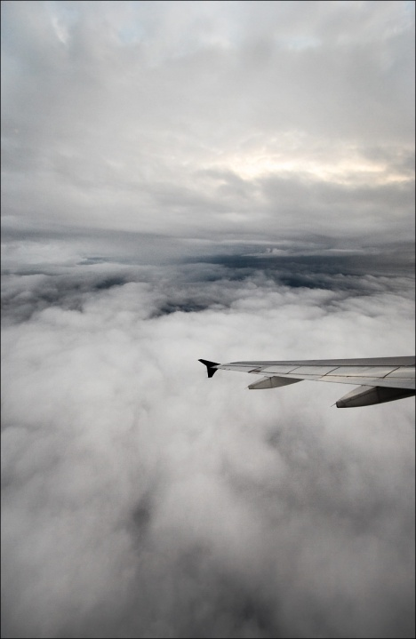 plane_wings_clouds_dark-opening