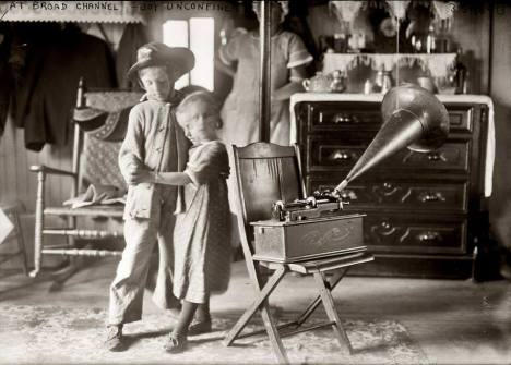 This 1915 photograph titled, Joy Unconfined features the dance steps of two children kept by the beat of an Edison phonograph.